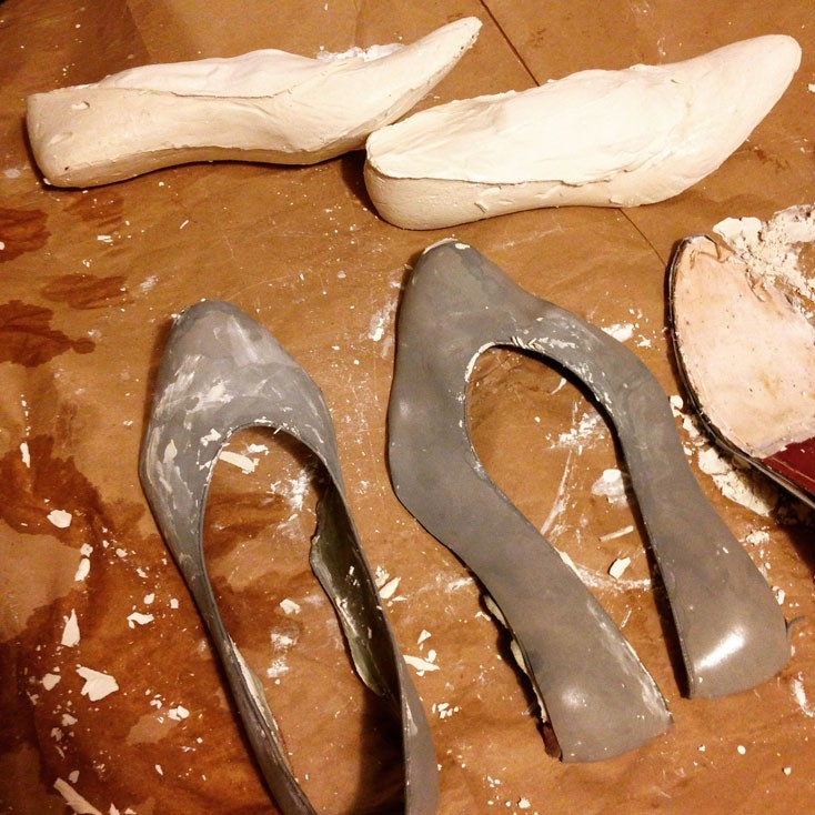 Lasts made out of vintage heels at the top of the pic, then the shoes were taken apart to create a pattern for the upper.